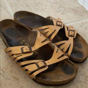 Copper strapped Birkenstock sandals